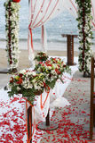 Beach Wedding Flowers. Wedding aisle decorated with rose petals and tropical flowers on the beach Royalty Free Stock Photos