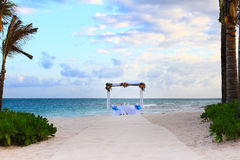Beach Wedding. Gazebo, chairs and glasses set up for a romantic beach wedding royalty free stock images
