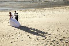 Beach Wedding IV. A newlywed couple on a sandy beach on their wedding day, Adelaide, South Australia stock image