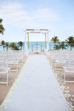 Beach Wedding - overlooking ocean. Beach wedding location in Miami, overlooking ocean. White chairs and tropical atmosphere Stock Photo
