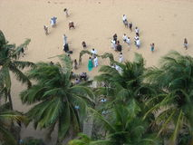 Beach Wedding Seen from Above. A wedding takes place on the beach at Luquillo, Puerto Rico Royalty Free Stock Photos