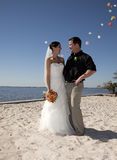 Beach wedding throwing flowers Stock Photos