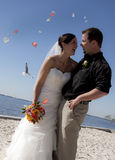 Beach wedding throwing flowers Stock Photo