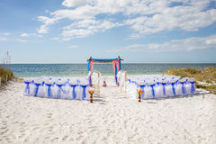 Beach Wedding. A tropical beach wedding ceremony arrangement on white sand, with bamboo canopy for an alter stock image