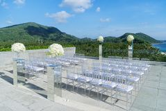 Beach Wedding Venue with mountain and ocean view background, Kog Samui, Thailand. The wedding venue decorated with the transparent chair, the glass box with Stock Photos