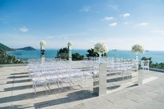 Beach Wedding Venue ocean view background, Koh Samui, Thailand. The decoration of wedding venue on the beach with the panoramic blue sky, the hill and ocean view Royalty Free Stock Image