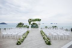 Beach wedding venue, The white chairs, Flower, Floral stock images