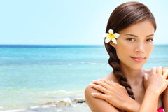 Beach wellness spa beauty woman. On Hawaii beach. Beautiful serene and peaceful young mixed race Asian Caucasian female model relaxing on holiday travel resort Royalty Free Stock Photos