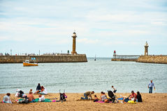 Beach at Whitby. Families on the beach within the harbour at Whitby in East Yorkshire Royalty Free Stock Image