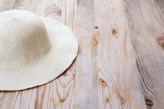 Beach white hat on clear pine wood Royalty Free Stock Images