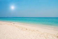 Beach with white sand and  blue sea Stock Images
