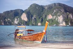 Beach with white sand landscape. Boat mooring in Asian style, canoe. Phi Phi Don. Thailand royalty free stock images
