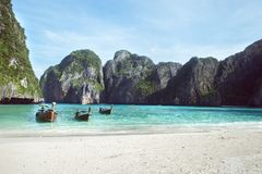 Beach with white sand landscape. Boat mooring in Asian style, canoe. Phi Phi Ley Thailand stock images