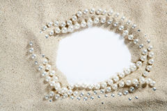 Beach white sand pearl necklace blank copy space. Beach white sand frame with pearl necklace and blank paper copy space Stock Photos