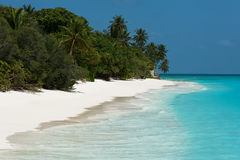 Beach with white sand and turquoise sea Royalty Free Stock Photos