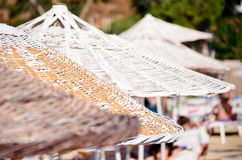 Beach white umbrellas in a row.Close up Stock Photos