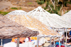 Beach white umbrellas in a row.Close up Royalty Free Stock Photography