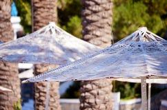 Beach white umbrellas in a row.Close up Stock Image