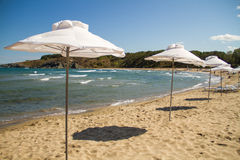 Beach. White umbrellas on a sandy beach Royalty Free Stock Photo