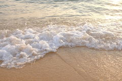 Beach white wave. Beach and white wave with sunset Stock Photography