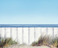Beach and White Wooden Fence Royalty Free Stock Photo