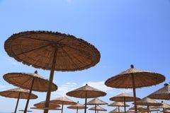 Beach wicker umbrella tops Royalty Free Stock Images