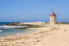Beach windmill Stock Photography