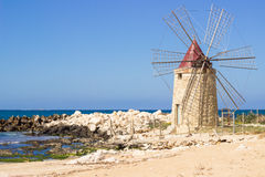Beach windmill Royalty Free Stock Images