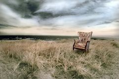 Beach with Wingback Chair stock images