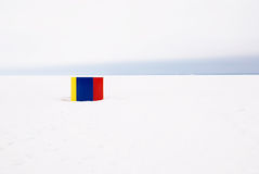On the beach in winter. Colorful cabin on a snowy beach of the Gulf of Finland Royalty Free Stock Image