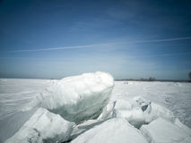 Beach in winter in Siberia. Ice breaks on the surface Royalty Free Stock Photos