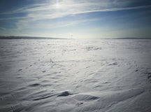 Beach in winter in Siberia. Snow and ice on the sea Stock Photos