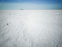 Beach in winter in Siberia. Snow and ice on the sea Stock Image