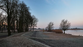 Beach in winter. Urban beach on the river in a frosty morning Royalty Free Stock Photography