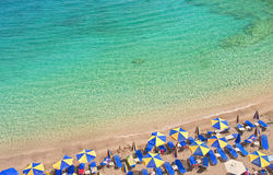 Beach With Colorful Umbrellas And Sunbeds And Beautiful Sea Stock Photo