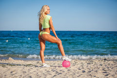 Beach woman in bikini holding a volleyball Royalty Free Stock Photo