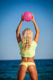 Beach woman in bikini holding a volleyball Royalty Free Stock Photo
