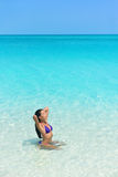 Beach woman in bikini swimming in blue ocean Royalty Free Stock Image