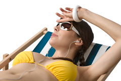 Beach - Woman with ear buds relax in bikini Stock Image