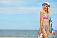 Beach woman funky happy. And colorful wearing sunglasses and beach hat having summer fun during travel holidays vacation stock photography