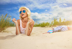 Beach woman funky happy. And colorful wearing sunglasses and beach hat having summer fun during travel holidays vacation royalty free stock photos