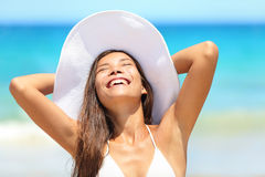 Beach woman happy on travel tanning Royalty Free Stock Image