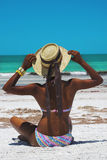 Beach woman with hat Stock Image