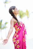Beach woman on Hawaii. Relaxing enjoying the sun in serene relaxed pose. Hawaiian scene with beautiful mixed race Asian and Caucasian female model wearing Royalty Free Stock Photo