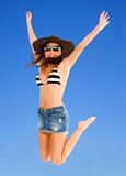 Beach woman jumping Stock Photography