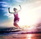 Beach Woman Jumping Summer Holiday Chilling Concept Stock Photography