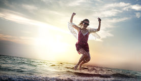Beach Woman Jumping Summer Holiday Chilling Concept Stock Image