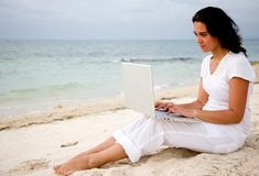 Beach woman with laptop Royalty Free Stock Photo