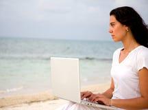 Beach woman on a laptop Stock Photo