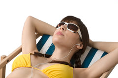 Beach - Woman listen to music in bikini Royalty Free Stock Photos